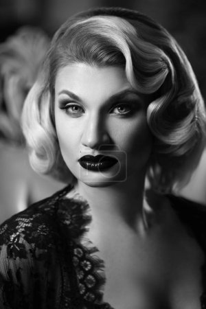 black and white vintage portrait of elegant blonde with waved hairstyle