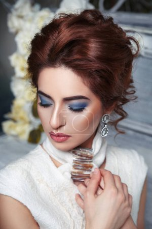 Photo for Elegant girl with bright makeup and hairstyle - Royalty Free Image