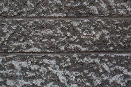 Photo pour Le fond texturel de plâtre gris à grain grossier décoré pour la maçonnerie . - image libre de droit