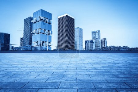 Photo for Urban skyscrapers with empty square floor tiles - Royalty Free Image