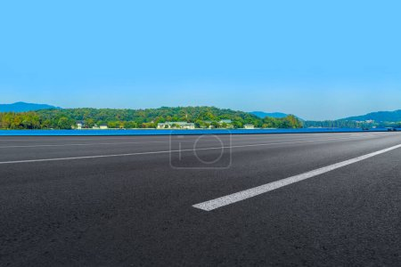 Photo for Empty asphalt road and natural landscape under the blue sky - Royalty Free Image