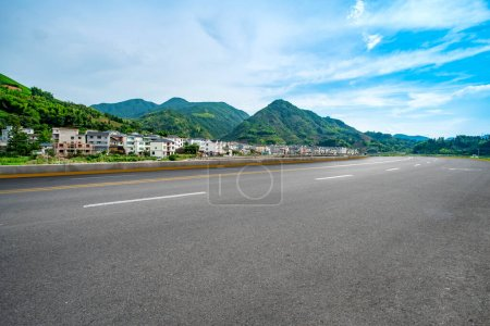 Photo for Empty asphalt road and natural landscape under the blue sky - Royalty Free Image