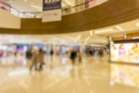 Abstract blur shopping mall of department store interior for bac