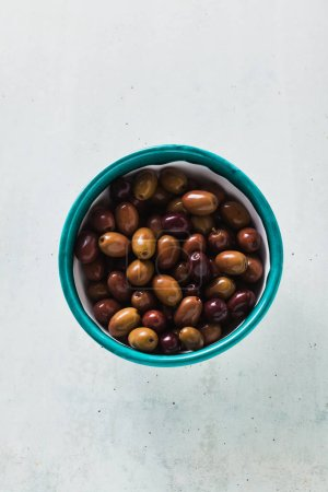 olives from a Kalamata in a bowl on a table. gaeta olives