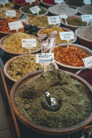 Photo for Plethora of spices in bowls with lettering papers - Royalty Free Image