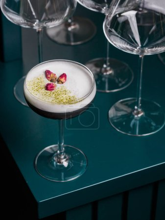 Alcoholic Cocktail with egg white foam and dried flowers