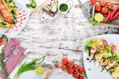 """Постер, картина, фотообои """"Питание. Набор из вкусный салат с авокадо и овощами. На фоне деревянные. Вид сверху. Копией пространства"""""""