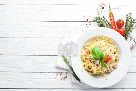 Photo for Pasta with bacon and cherry tomatoes. Italian dish. Free space for your text. Top view. - Royalty Free Image