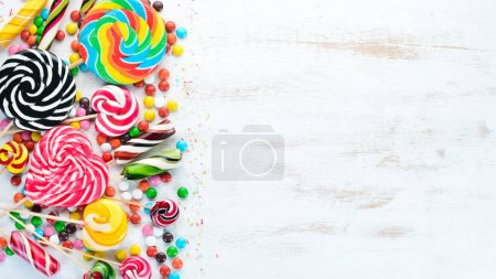Photo for Colorful candies, jelly and marmalade on a white wooden background. Sweets. Top view. free copy space. - Royalty Free Image