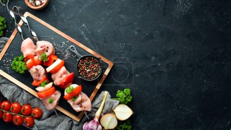 Photo for Raw chicken shish kebab with vegetables and spices. Top view. Free space for your text. Rustic style. - Royalty Free Image