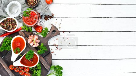 Photo for Ketchup, barbecue sauce, tomato sauce. A set of tomato sauces on a white wooden background. Top view. Free space for your text. - Royalty Free Image
