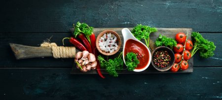 Photo for Set of red sauces on a wooden background. Ketchup, barbecue sauce, tomato sauce. Top view. Free space for your text. - Royalty Free Image