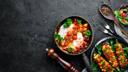 Photo for Shakshuka Eggs with tomatoes and vegetables in a frying pan. Breakfast. Top view. Free space for your text. - Royalty Free Image
