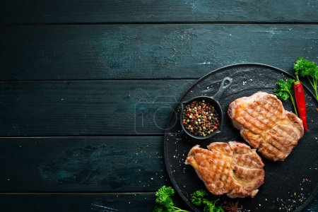 Photo for Grilled pork steak with spices and herbs. Top view. Free space for your text. - Royalty Free Image