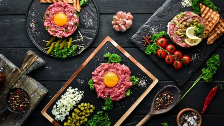 Photo for French traditional cuisine. Tartar with egg, avocado, onion and pickled cucumber. Top view. Free space for your text. - Royalty Free Image