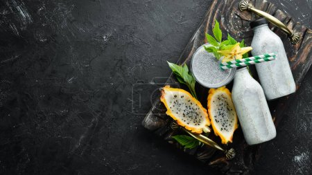 Photo for Smoothies from a dragon fruit on a black background. Top view. Free space for text. - Royalty Free Image