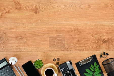 Photo for Brown office table with laptop, calculator and camera. Top view. Free space for your text. Flat lay. - Royalty Free Image
