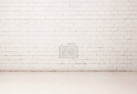 Photo for Blank white brick wall with a piece of light floor. Copy space text. - Royalty Free Image