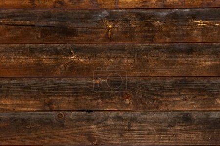 Photo pour Image de fond texture des planches brun foncé avec noeuds et noircissement - image libre de droit