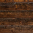 Background image texture of dark brown boards with...