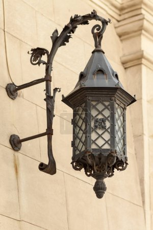 Street lamp on the wall of an old house