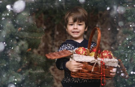 Photo for A little child by the New Year tree. Children decorate the Christmas tree - Royalty Free Image