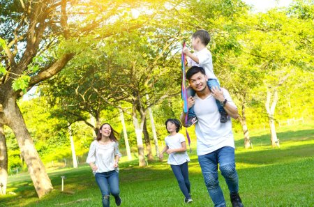 Photo for Asian family enjoyed outdoor activity in the park - Royalty Free Image