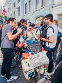 Russia, Moscow, FIFA World Cup: June 15, 2018 . Journalists interviewed by the traveler Matthias Amaya, who overcame more than 80,000 km in 5 years, making a round-the-world trip on bicycle. Matthias