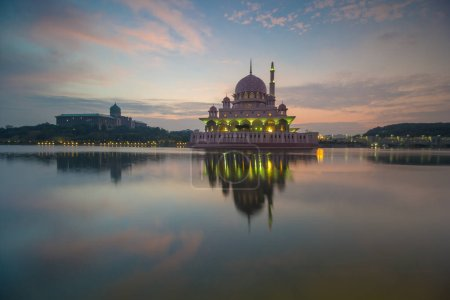 reflection of a mosque at sunrise hour