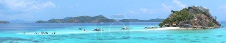 Sandbar with tourists and boats on the tropical Bulog Uno island, Palawan, Philippines