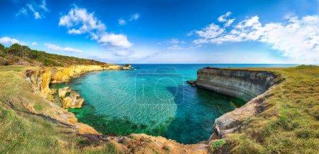 Photo for Picturesque seascape with white rocky cliffs, sea bay, islets and faraglioni near by beach Spiaggia della Punticeddha, Salento Adriatic sea coast, Puglia, Italy - Royalty Free Image
