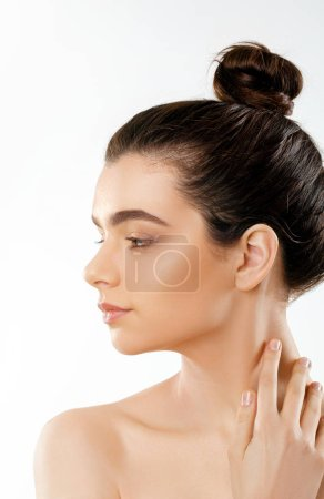 Beauty and Spa Concept. Beautiful Young Woman with Clean Fresh Skin touch own face.Facial treatment. Girl Female  With Natural Makeup.Cosmetology.