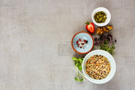 Photo for Flat lay of clean eating healthy food selection. Micro greens, nuts, seeds, superfood, berry, cereals on light background. Ingredients for cooking. Food background with copy space. Top view - Royalty Free Image