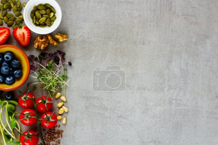 Photo for Healthy food clean eating selection close up. Berry, vegetable, micro greens, nuts, seeds, superfood on light background. Ingredients for cooking. Food background with copy space. Top view, flat lay - Royalty Free Image