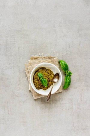 Photo for Flat lay of fresh basil pesto sauce top view, copy space. - Royalty Free Image