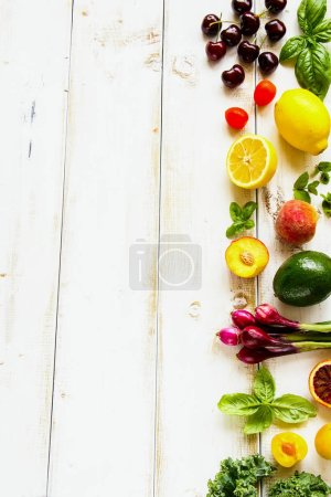 Photo for Summer food concept. Seasonal fruit, vegetables and greens flat lay. Healthy life and vegetarian, vegan, dieting, clean eating ingredients - Royalty Free Image