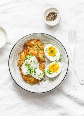 Photo for Potato latkes and boiled egg - healthy breakfast or snack on light background, top view - Royalty Free Image