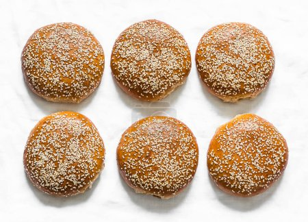 Photo for Homemade whole wheat hamburger rolls on a light background, top view - Royalty Free Image