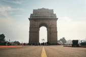 India Gate on the background of cloudy sky, Sightseeing in new Delhi. view from the road.