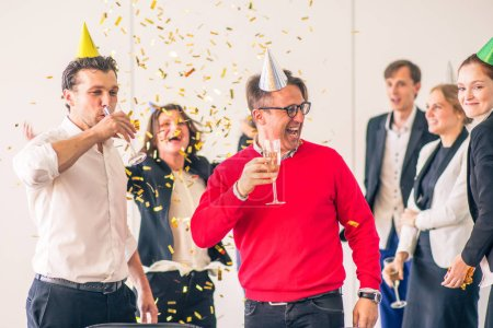 Photo for Business people celebrating victory at office party holding glasses of champagne - Royalty Free Image