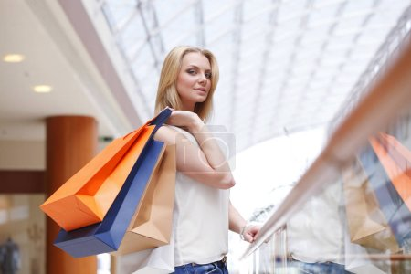 Photo for Fashion shopping woman walking with bags in shopping mall - Royalty Free Image