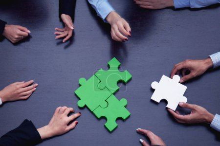 Photo for Group of business people assembling jigsaw puzzle, team support problem solution and help concept - Royalty Free Image