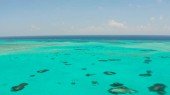 Seascape with coral reef and atoll in the blue sea Balabac, Palawan, Philippines.
