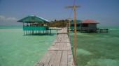 Tropical island with a beach on the atoll. Onok Island Balabac, Philippines.