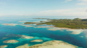 Seascape with tropical islands and turquoise water.