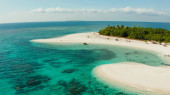 Tropical island with sandy beach. Balabac, Palawan, Philippines.
