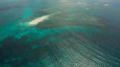 Sandy island with a beach and tourists. Naked Island, Siargao