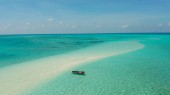 Sandy beach in the lagoon with turquoise water. Balabac, Palawan, Philippines.