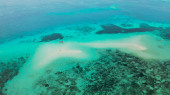 Seascape with tropical islands and coral reef. Balabac, Palawan, Philippines.