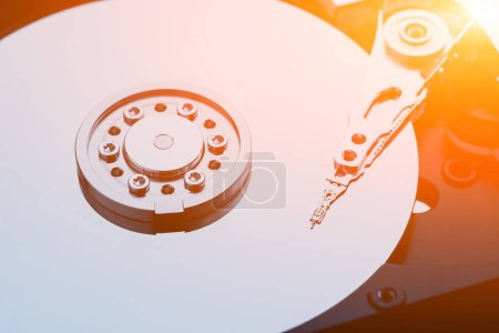 Photo for Closeup macro photo of head in opened hard disk drive. Concept of repair or recovery information from broken HDD - Royalty Free Image